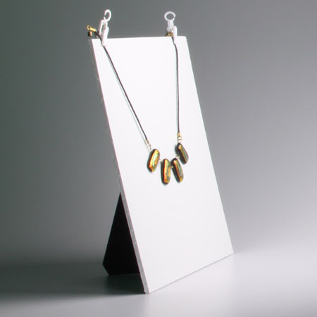 Necklace suspended on background