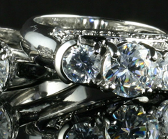 Diamond Rings on Black Refective Riser photographed with Diamond Dazzler LED Bulb